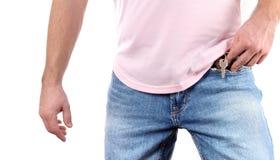 Man put keys in a jeans pocket. Man put keys in pocket of his jeans Stock Photo