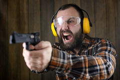 Man with put on protective goggles and ear training in pistol sh Royalty Free Stock Image