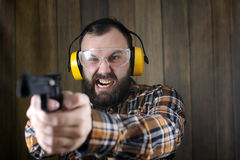 Man with put on protective goggles and ear training in pistol sh Royalty Free Stock Photography