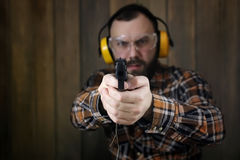 Man with put on protective goggles and ear training in pistol sh Stock Images