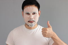Man put on treatment mask. His wife ask him to treatment his face stock images