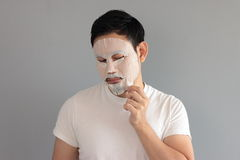 Man put on treatment mask. His wife ask him to treatment his face stock photos