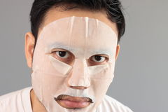 Man put on treatment mask. His wife ask him to treatment his face royalty free stock image