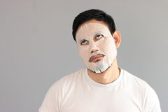 Man put on treatment mask. His wife ask him to treatment his face royalty free stock photography