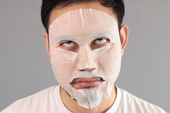Man put on treatment mask. His wife ask him to treatment his face royalty free stock photos