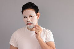 Man put on treatment mask. His wife ask him to treatment his face stock photo