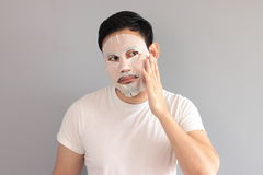 Man put on treatment mask. His wife ask him to treatment his face stock photography