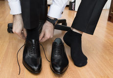 Man puting on his shoes. Royalty Free Stock Photos
