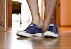 Man is puting on  sneakers Royalty Free Stock Photography