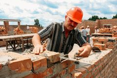 Man Puts A Brick Stock Photography