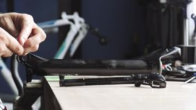 Man puts the bicycle parts on the table