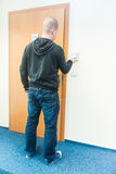 Man puts the card into the reader access control Royalty Free Stock Image