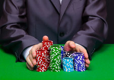 Man puts in the casino. Hand with chips Stock Photos