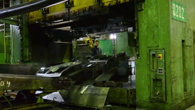Man puts component under press machine AutoVAZ factory on September 30, 2011 in Togliatti, Russia. TOGLIATTI - SEP 30: Man puts component under press machine stock footage