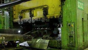 Man puts component under press machine. TOGLIATTI - SEP 30: Man puts component under press machine AutoVAZ factory on September 30, 2011 in Togliatti, Russia stock video footage
