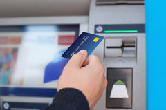 Man puts credit card into ATM Royalty Free Stock Photo