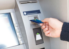 Man puts credit card into ATM Royalty Free Stock Photos