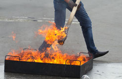 Man puts on fire a torch Stock Photography