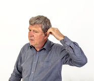 Man  puts hearing aid in the ear Royalty Free Stock Photos