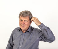 Man  puts hearing aid in the ear Stock Photos