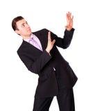 Man puts his hands resisting danger Stock Photo