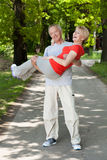 Man puts his wife in his arms Stock Photography