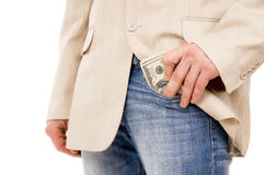 The man puts the money in his pants pocket Royalty Free Stock Image