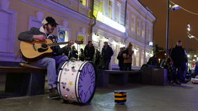 The man puts the money musician playing guitar in the center of Moscow. stock video footage