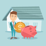 Man puts money into piggy bank for buying house. Stock Images