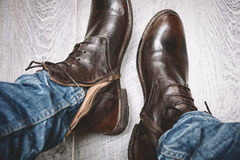 Man puts shoes on his feet, a top view Royalty Free Stock Photo