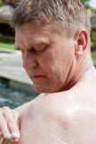 Man puts on skin protective cream Stock Image