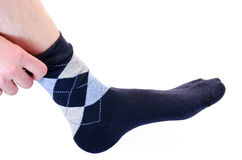The man puts on a sock Royalty Free Stock Photography