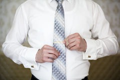 Man puts on tie clip Stock Photo