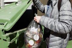 Man puts garbage in trash Royalty Free Stock Photos