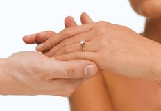 Man puts wedding ring on woman hand Stock Image