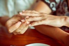 man puts woman engagement ring Royalty Free Stock Photo