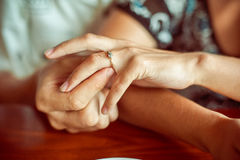man puts woman engagement ring Royalty Free Stock Photography