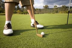 Man putting. Man about to putt at golf course in australia Stock Images