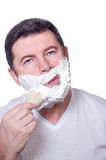 Man putting beard foam Stock Images