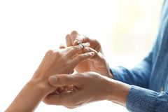 Man putting beautiful engagement ring on his beloved. Closeup Stock Photography