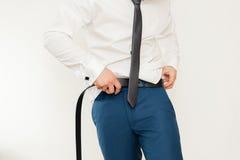 Man putting on belt Royalty Free Stock Photo