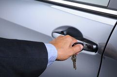 Man Putting Car Key into Door Lock Stock Photography