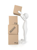 Man putting cardboard box Royalty Free Stock Image