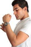 Man putting on chronograph watch Stock Image