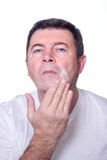 Man putting cream stock photography