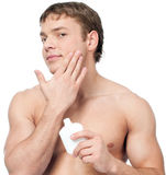 Man putting on cream lotion royalty free stock photos