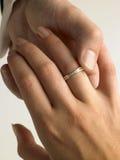 Man Putting Diamond Ring On Woman's Finger Royalty Free Stock Photos
