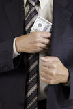 Man putting dollars pack into pocket Royalty Free Stock Photography