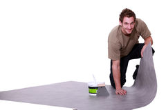 Man putting down  flooring Stock Image