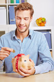 Man putting Euro money coin Royalty Free Stock Photography